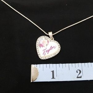 Silver color necklace with Taylor heart charm
